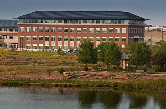 A view of centerra buildings from across equalizer lake.