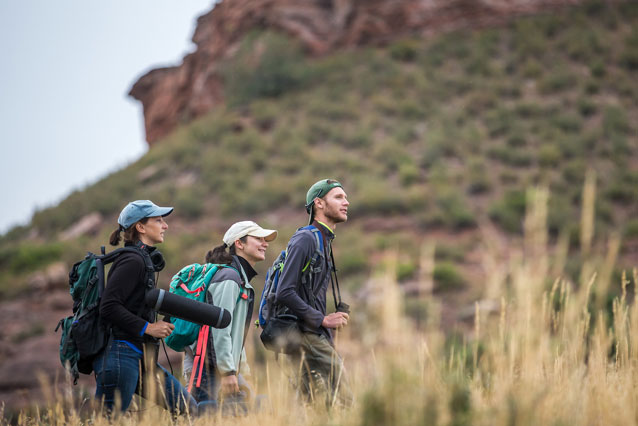 UNC Extended Campus students walking mountainside for field experience